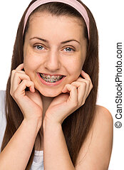 Smiling girl with braces isolated