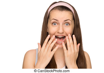 Excited girl with braces shouting isolated - Excited girl...