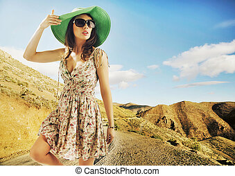 Brunette cutie with huge sunglasses and green hat