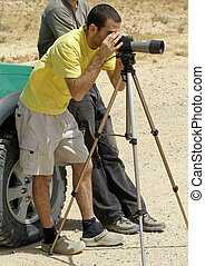 telescope - bird watcher sede boker desert, israel