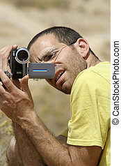 camera - bird watcher sede boker desert, israel