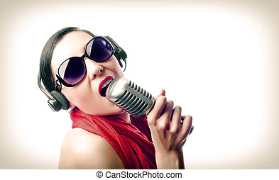 Girl with microphone - Beautiful girl in the red with...