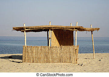 reed hut on beach, red sea, sinai, egypt