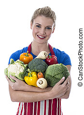Model Released. Attractive Young Woman Holding Fresh Raw...