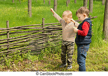 Two little boys celebrating lighting a fire - Two little...