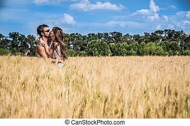 Couple in love kissing in argentinean countryside fields....