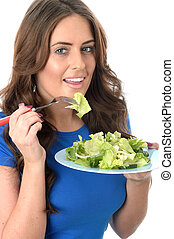 Attractive Young Woman Eating a Green Salad