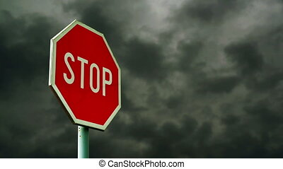Red stop sign on the street. Roadside traffic sign for...