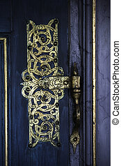 Gold hinge - Gpold Ornametal Hinge On A blue Door