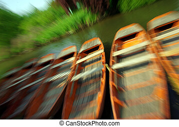 Rowboats - View of some typical rowboats with speed effect.