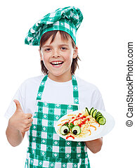Happy boy chef with creative pasta dish
