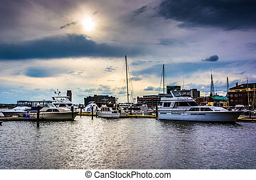 Dramatic sky over a marina in Fells Point, Baltimore, Maryland.