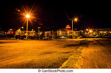 Empty parking lot and Little Havana Restaurant at night in Baltimore, Maryland.