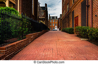 Brick alley and houses in Fells Point, Baltimore, Maryland....