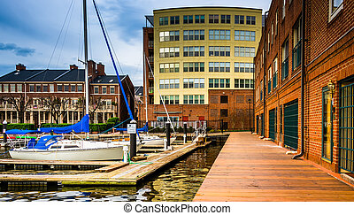Boats and buildings on the waterfront in Fells Point,...