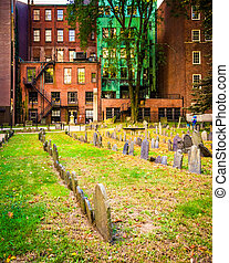 Historic cemetery and old buildings in Boston, Massachusetts.