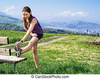 Stretching before jogging - Photo of a young woman...
