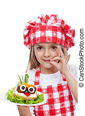 Little chef with creative food - onion hair on meatball eyed...