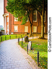 Path and building at an old cemetery in Boston, Massachusetts.