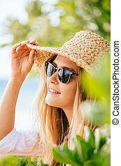 Woman in sun hat on the beach - Attractive woman in sun hat...