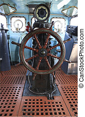 old wood boat steering wheel in military war ship