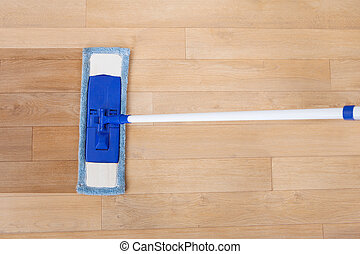 Hardwood Floor Being Cleaned By Mop - Directly above shot of...