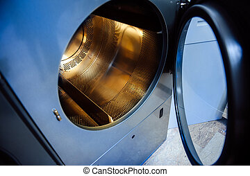 Washing machine with gold plated drum - concept of wealth,...