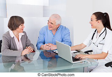 Senior Couple Consulting Doctor