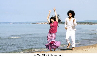 Couple in love dancing happy on sea