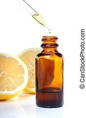 Herbal medicine dropper bottle with lemons on white...