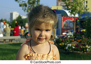 Little girl in park.