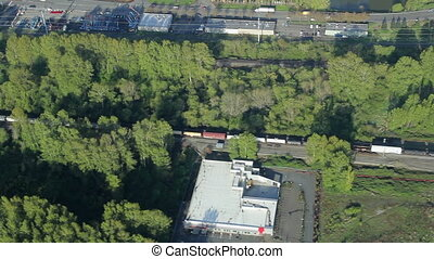 Freight Train in Industrial Area - Low-altitude...