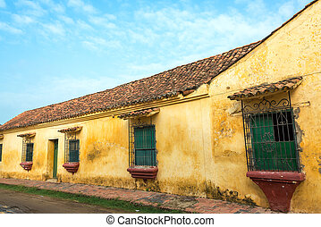 Yellow Colonial Building - Yellow colonial building with...