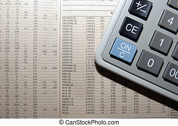 Calculator and business newspaper. Financial concept.