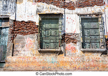 Old Damaged Building - Old damaged colonial building in the...