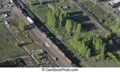 Freight Train Passing Station - Low-altitude airplane...