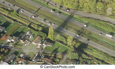 Trucks and Cars on Interstate - Overhead perspective of...