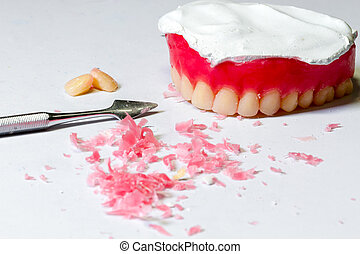 tool for make a wax dentures model. table of dental technician workplace.