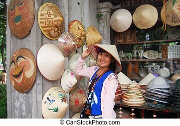 hat Shop at Hanoi Vietnam - Traveler Thai Woman with conical...