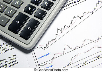 Calculator and printed business report.
