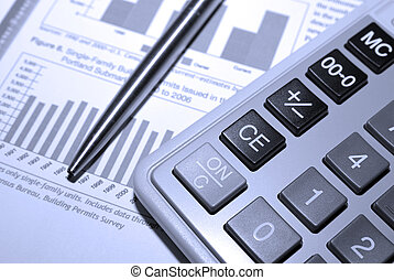 Calculator, steel pen and financial analysis report