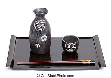 japanese sake bottle and cup on white background