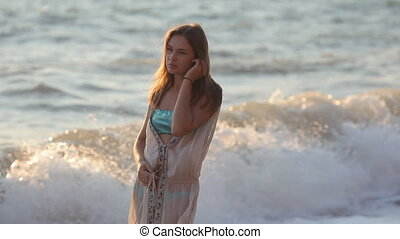 Sad girl standing on the beach - Carefree woman in the...