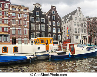 Boats on a canal in Amsterdam Netherlands