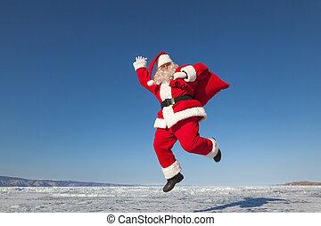 Jumping Santa Claus outdoors - Santa Claus joyously jumping...