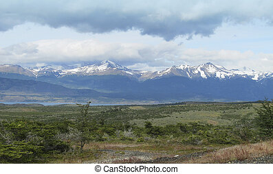 Patagonian landscape with lake and mountains. Horizontal.