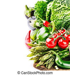 Fresh organic vegetables isolated over white background