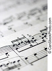 Old musical sheet\'s fragment.