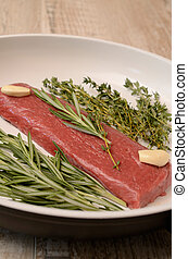 Lamb steaks with herbs
