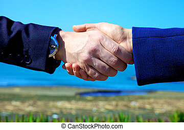 Hand shake between business people - Strong confident hand...